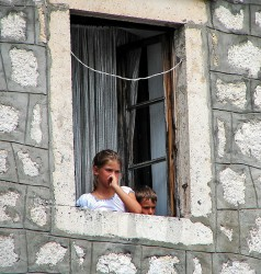 Boy and Girl Daydreaming Out of Their Window